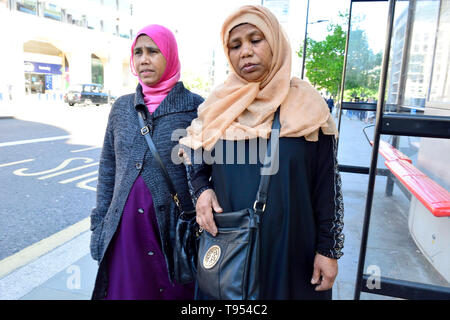 London, England, UK. Two Muslim women wearing headscarves walking in Holborn - Stock Photo