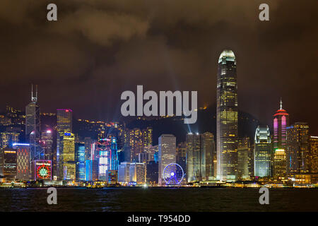Victoria Harbour at night, Hong Kong, SAR, China - Stock Photo