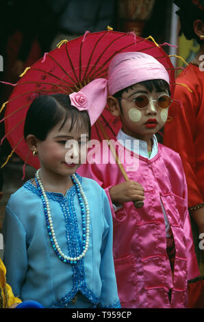 Myanmar. Namhkam. Shan tribe children. Boy and girl couple. - Stock Photo