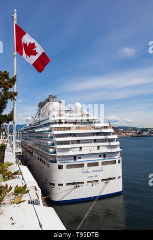 The Coral Princess cruise vessel taking on supplies and passengers at the Port of Vancouver in British Columbia Canada - Stock Photo