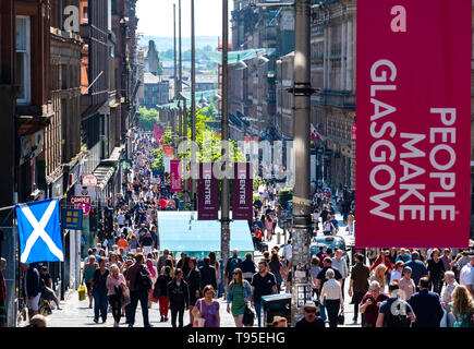 Busy pedestrian Buchanan Street in Glasgow City centre on a warm sunny afternoon, Glasgow, Scotland, UK - Stock Photo