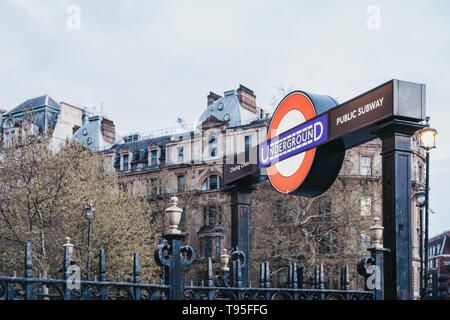 London, UK - April 14, 2019: London Underground sign at the entrance of Charing Cross station from Trafalgar Square. London Underground is the oldest  - Stock Photo