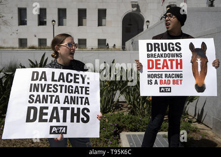 Los Angeles, CA, USA. 14th Mar, 2019. Demonstrators are seen holding placards during the protest.Animal right activists held a PETA protest against the death of 22 horses at the Santa Anita Racetrack. The protesters holding placards also called on the Los Angeles District Attorney to open a criminal investigation and suspend racing while investigating the cause of the death. Credit: Ronen Tivony/SOPA Images/ZUMA Wire/Alamy Live News - Stock Photo