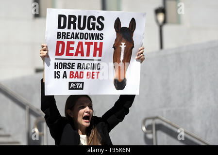 Los Angeles, CA, USA. 14th Mar, 2019. A demonstrator seen shouting slogans while holding a placard that says drugs breakdown death, horse racing is a bad bet during the protest.Animal right activists held a PETA protest against the death of 22 horses at the Santa Anita Racetrack. The protesters holding placards also called on the Los Angeles District Attorney to open a criminal investigation and suspend racing while investigating the cause of the death. Credit: Ronen Tivony/SOPA Images/ZUMA Wire/Alamy Live News - Stock Photo