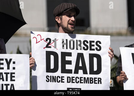 Los Angeles, CA, USA. 14th Mar, 2019. A demonstrator seen shouting slogans while holding a placard that says 22 horses dead sing December during the protest.Animal right activists held a PETA protest against the death of 22 horses at the Santa Anita Racetrack. The protesters holding placards also called on the Los Angeles District Attorney to open a criminal investigation and suspend racing while investigating the cause of the death. Credit: Ronen Tivony/SOPA Images/ZUMA Wire/Alamy Live News - Stock Photo