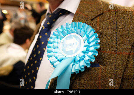 Dudley, West Midlands, England, UK - Friday 17th May 2019 – A Brexit Party candidate wears a rosette during the Brexit Party tour event at Dudley, West Midlands ahead of next weeks European Parliament elections – The town of Dudley voted 67% in favour of leaving the EU in the 2016 referendum. Photo Steven May / Alamy Live News - Stock Photo