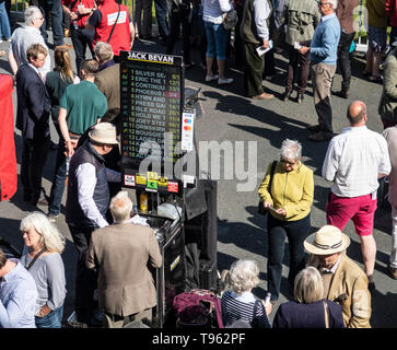 Track side bookmakers at Newton Abbot racecourse, Devon, UK. Bookies at the races, horse racoing course. - Stock Photo