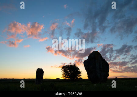 West Kennet Avenue stones in Avebury stone circle in the spring at sunrise. Avebury, Wiltshire, England. Silhouette - Stock Photo