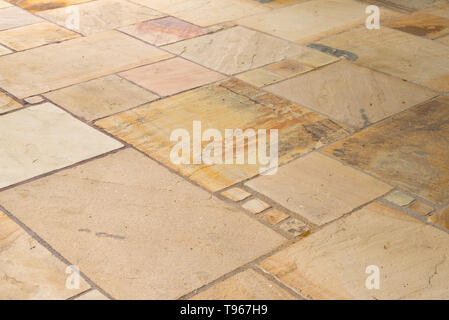 Lime-sandstone slabs laid irregularly on the terrace - Stock Photo
