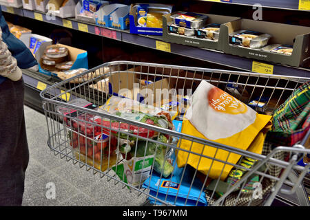 Grocery shopping with trolley in supermarket