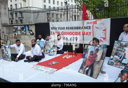 Tamils demonstrating opposite 10 Downing Street, Whitehall, London, UK in remembrance of the Tamil genocide 10 years ago. - Stock Photo