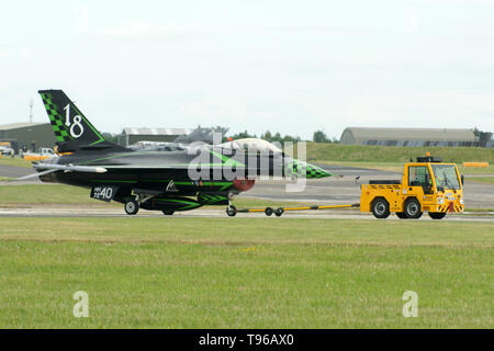 General Dynamics F-16 Fighting Falcon on airfield towing unit