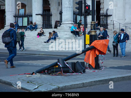 London, UK. 16th May 2019. Traffic and pedestrian road signs knocked over by a large vehicle in the middle of the road next to Trafalgar Square. - Stock Photo