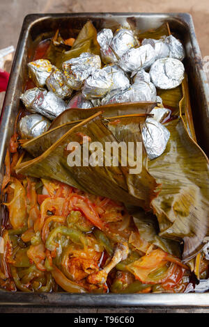 Mexico food - food cooked in a traditional earth oven ( Underground oven ); Campeche Yucatan Mexico Latin America - Stock Photo
