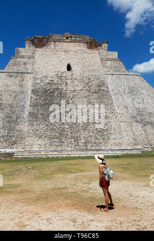 Mexico tourist - a tourist looking at the Pyramid of the Magician, UNESCO world heritage site, Uxmal, Yucatan, Mexico Latin America - Stock Photo