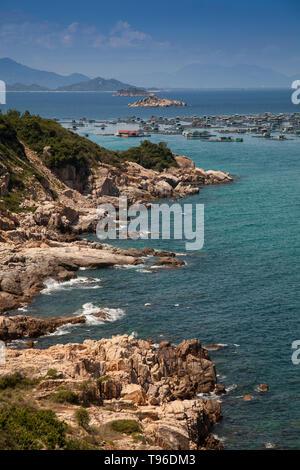 Rocky coast landscape near the floating market Binh Hung at Vinh Hy, South China Sea,Ninh Thuan, Vietnam - Stock Photo