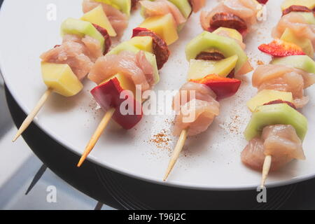 Raw Shashlik Skewers from Meat and Vegetables Closeup - Stock Photo