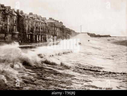 A late 19th Century view of  stormy seas battering the seafront in Blackpool, a seaside resort on the Lancashire Irish Sea coast, between the Ribble and Wyre estuaries, in North West England.  It became fashionable in the middle of the 18th century due to the practice of sea bathing to cure diseases, with the completion of a branch railway line to Blackpool. Tourist growth was intensified by the practice among the Lancashire cotton mill owners of closing the factories for a week every year to service and repair machinery. - Stock Photo