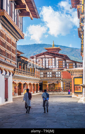 Two monks strolling in the courtyard of Rinpung Dzong, also known as Paro Dzong, Bhutan - Stock Photo