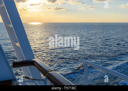 View from the deck of the cruise ship to the ocean. Sea horizon, clouds, blue tropical sky - Stock Photo