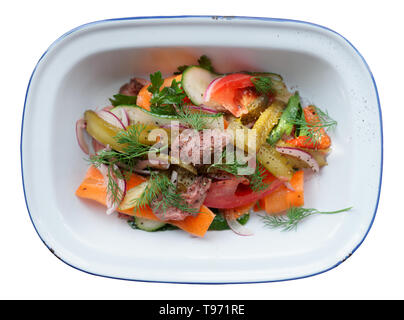 Appetizer made of roast beef and vegetables in enamel plate isolated on white balckground - Stock Photo