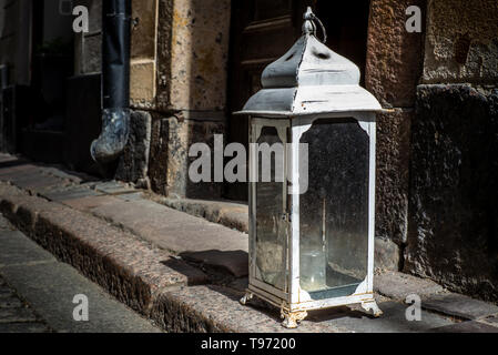An old vintage lantern with candle at the entrance of a house in Stockholm - Stock Photo