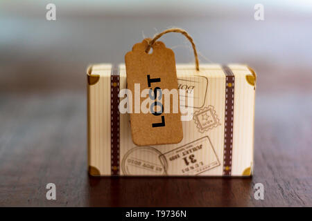 Luggage with the word Lost written on label - Stock Photo