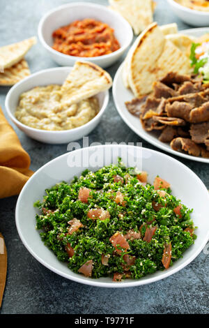 Parsley tabbouleh with tomato and cous cous - Stock Photo