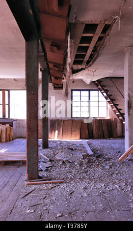ceiling collapsing in old building - Stock Photo