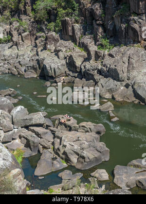 TASMANIA, AUSTRALIA - FEBRUARY 15, 2019: Two unidentified women sunbathing in Cataract Gorge, in Launceston, Tasmania, one of the region's premier tou - Stock Photo