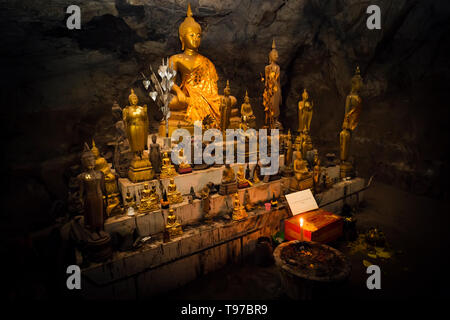 Inside Pak U cave are many gold-plated buddha-figures. The cave is situated near Luang Prabang, Laos. - Stock Photo