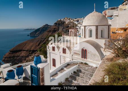 Beautiful White Domed Orthodox Church overlooking the Caldera, Fira, Santorini, Greek Islands, Greece - Stock Photo