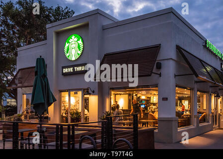 Early morning activity at Starbucks Coffee in Jacksonville Beach, Florida. (USA) - Stock Photo