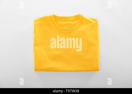 Blank yellow t-shirt on white background - Stock Photo