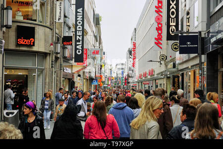 Crowded Shopping Street in Cologne Germany - Stock Photo