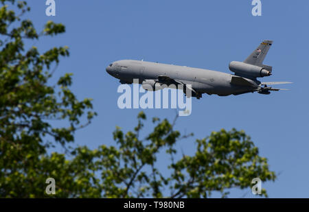 A KC-10 Extender with the 305th Air Mobility Wing, Joint Base McGuire-Dix-Lakehurst, N.J., takes off from the flight line May 15, 2019, at Dover Air Force Base, Del. The aircraft can transport nearly 170,000 pounds of cargo and up to 75 people a distance of about 4,400 miles. (U.S. Air Force photo by Senior Airman Christopher Quail) - Stock Photo