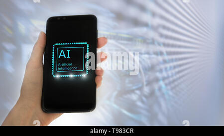 Female hand holds the phone, on the screen the inscription: artificial intelligence. icon hologram 3D on server room background - Stock Photo