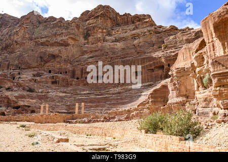 Stunning view of a huge temple carved in stone in the beautiful Petra site. - Stock Photo