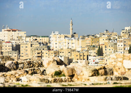 (Selective focus) Stunning view of the Amman skyline seen from the Amman Citadel in Jordan with a mosque in the distance. - Stock Photo