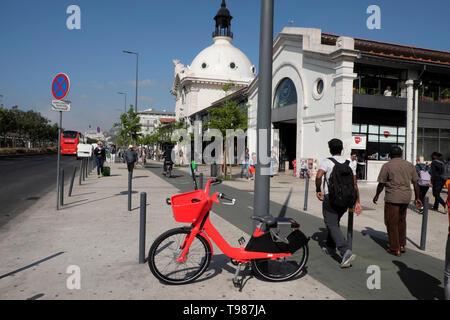 People red Jump electric bike share bicycle parked outside Time Out Market building on Avenida 24 de Juhlo in Lisbon Portugal Europe   KATHY DEWITT - Stock Photo