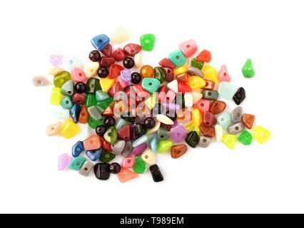 Colorful beads. Glass, seed beads and felted beads for jewelry making on white background. Hobby, handmade, fine arts.