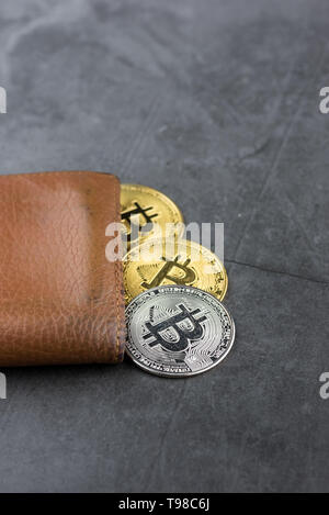View of metal bitcoins in brown leather wallet.Concept image for cryptocurrency - Stock Photo