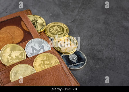 View of different kind of metal bitcoins in brown leather wallet.Concept image for cryptocurrency - Stock Photo