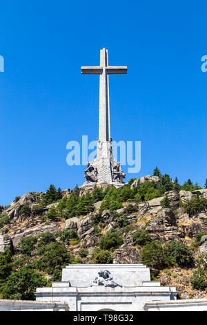 The gigantic cross on the top of the Valley of the Fallen, Valle de Los Caidos , the burying place of the Dictator Franco on the Sierra the Guadarrama - Stock Photo