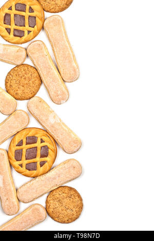 Savoiardi cookies, oat cookies and tarts with dark chocolate isolated on white background. Top view with copy space. - Stock Photo