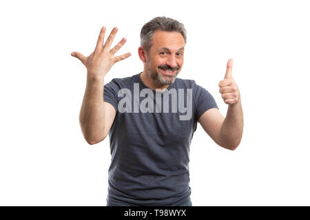 Smiling man counting by holding six fingers up as sixth concept isolated on white studio background - Stock Photo