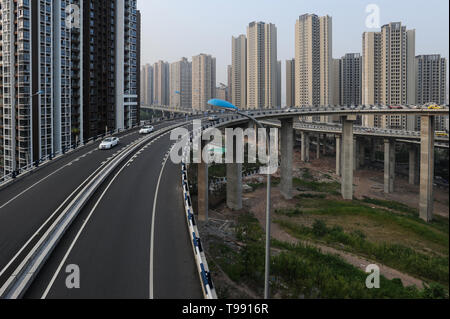 03.08.2012, Chongqing, , China - New skyscraper settlements and highways on the outskirts of the Metrople. The megacity lies at the confluence of two  - Stock Photo