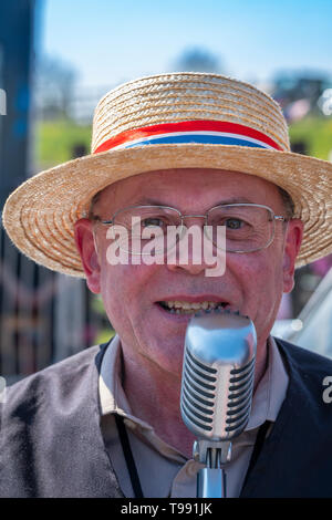 Old time singer at a steam engine rally. - Stock Photo
