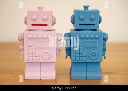 pink and blue robots - male and female - Stock Photo