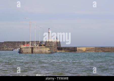 Anglers Sea fishing from the Harbour Wall at St Monans, Fife, Scotland, UK. - Stock Photo